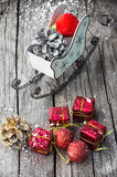 Christmas card with sleigh and ornaments Stock Photo