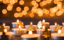 Christmas card with small candles and golden ornaments Royalty Free Stock Photos
