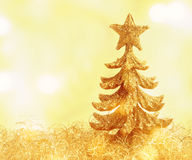 Christmas Card. Small christmas tree with gold background and copy space Royalty Free Stock Image