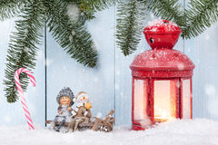 Christmas card. With smiling figurines, Christmas lantern and candy canes Royalty Free Stock Photos