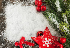 Christmas card with snow, red star and fir-tree branch Royalty Free Stock Photos