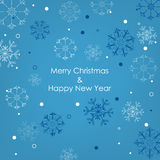Christmas card with snowflakes on a blue background Stock Photo
