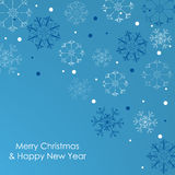 Christmas card with snowflakes on a blue background Stock Image