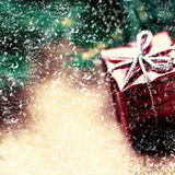 Christmas card with  snowflakes, present box and fir cone tree o Royalty Free Stock Images