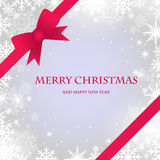 Christmas card with snowflakes and red bow Royalty Free Stock Photo