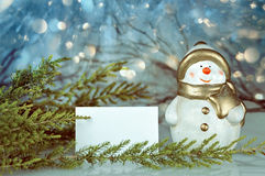 Christmas card, Snowman and Christmas lights Royalty Free Stock Images