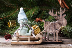 Christmas card with snowman and deer Stock Image
