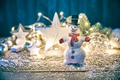 Christmas card with snowman hare and snow Stock Images
