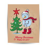 Christmas card with a snowman in the middle Royalty Free Stock Photo