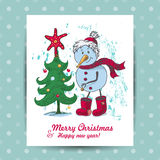 Christmas card with a snowman in the middle Royalty Free Stock Image
