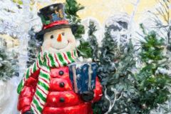 Christmas card with a snowman. Stock Photography