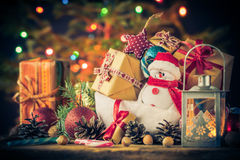 Christmas card Snowman ornaments gifts tree lights background Stock Photo