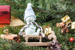 Christmas card with snowman on sled Royalty Free Stock Photography