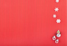 Christmas card with snowman, two cups with hearts and snowflakes on red corrugated paper stock images