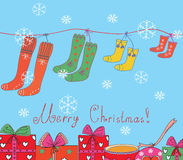 Christmas card with socks Royalty Free Stock Photos