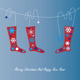 Christmas card with socks and snowflake Royalty Free Stock Images