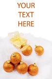 Christmas card with spheres. And golden box on a white background Royalty Free Stock Image