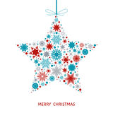 Christmas  card with  star with red, blue and gray snowflakes. Royalty Free Stock Photo