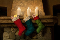 Christmas card. Stocking on fireplace background. royalty free stock photo