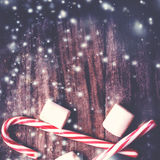 Christmas Card with  striped hard candy cane and marshmallows ov Royalty Free Stock Photo