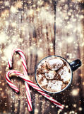 Christmas Card with striped hard candy cane and marshmallows ove Stock Photo