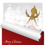 Christmas card with sweet deer looking at the magic glow in the snowy forest background. Royalty Free Stock Images