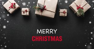 Christmas card. Symmetrically arranged gifts at the top of the image. Christmas greetings message. The Xmas ambience is. Christmas card. Symmetrically arranged Royalty Free Stock Image