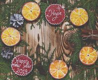 Christmas card: Tangerines, gingerbread cookies from orange slices, a Christmas star and greetings on Christmas royalty free stock photo
