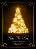 Christmas card, tarjeta navide�a. Warmly sparkling Christmas tree made of our of focus  lights on dark brown background with the text Feliz Navidad y Pr� Stock Image