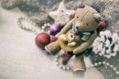 Christmas card with Teddy bear, necklace, pine cone, Christmas tree toys for your design. Grunge Christmas background. Stock Photography