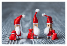 Christmas card template. Clothespin Santa Clauses. Retro Santa Claus with a few bags of gifts. Royalty Free Stock Photo