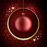 Christmas card template - red bauble and stars. On patterned background Stock Photo