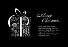 Christmas card black and white template. Christmas card template with white christmas gift box made from snowflakes Royalty Free Stock Images