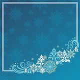 Christmas card. Tender blue frame with christmas trees and snow Royalty Free Stock Photography