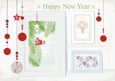 Christmas Card with themed interior. Design illustration for a festive Christmas Card with hanging ornaments and a themed interior with artwork of Santas sleigh Royalty Free Stock Photos