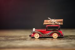 Christmas card with toy car and cinnamon on black. Background royalty free stock images