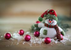 Christmas card. toy snowman on a festive background. Photo with place for text Royalty Free Stock Photos