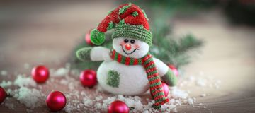 Christmas card. toy snowman on a festive background. Photo with place for text Stock Images
