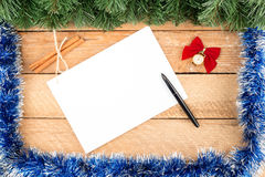 Christmas card, tree branches, paper, watch, pen, cinnamon, with Stock Photography
