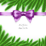 Christmas card with tree branches and purple bow Royalty Free Stock Photo