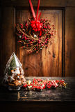 Christmas card with tree from glass, cookies and holiday decorations on wooden background with wreath and ribbon Royalty Free Stock Images