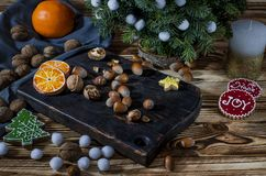 Tree, Orange, orange slices and biscuits snowflakes lie on the wood table stock photography