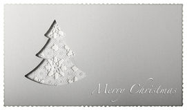 Christmas card tree on paper. Christmas card tree cut on paper with greeting text Stock Photos