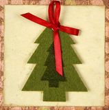 Christmas Card with tree and red ribbon stock images