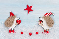 Christmas card with two hedgehogs Stock Image
