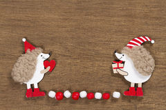 Christmas card with two hedgehogs Royalty Free Stock Photos