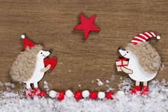 Christmas card with two hedgehogs Stock Images