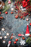 Christmas card with various winter decorations, cookie,snow and wreath on vintage blue background Stock Images