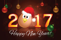 2017 Christmas card Vector illustration. 2017 Christmas card with a chicken in a Christmas hat and Christmas balls on a dark background. Vector illustration Stock Photo