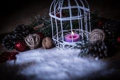 Christmas card.vintage Christmas candle on festive background . Stock Image